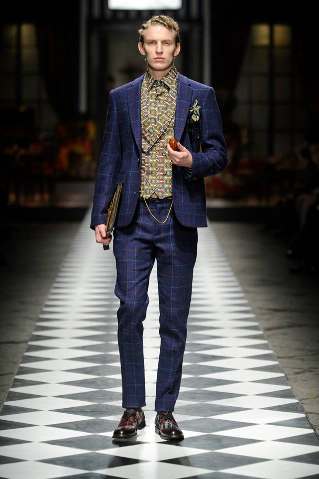 e96cfb7b1aac1 The collection itself is also a truly chic menswear collection filled with  a plethora of magnificent African inspired prints in suits, trench coats,  blazers ...
